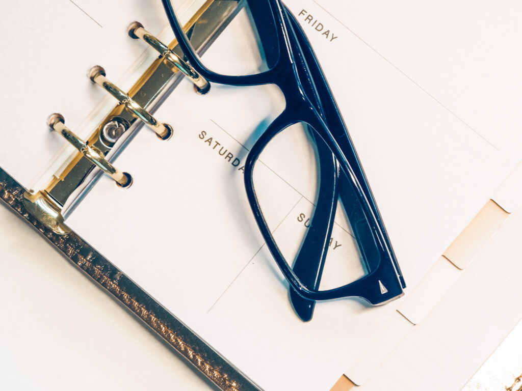 tuesday favorites planner and glasses